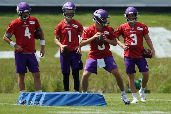 Vikings quarterbacks Sean Mannion (4), Kyle Sloter (1), Kirk Cousins (8), and Jake Browning (3), took part in drills during training camp last year.