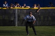 Esko players watched a game from the outfield fence as they waited for their game to start last June 6 at the girls' softball state tournament in Nort