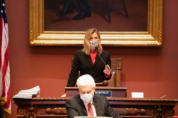 A masked House Speaker Melissa Hortman, DFL-Brooklyn Park prepared for the House session on Tuesday under social-distancing rules.
