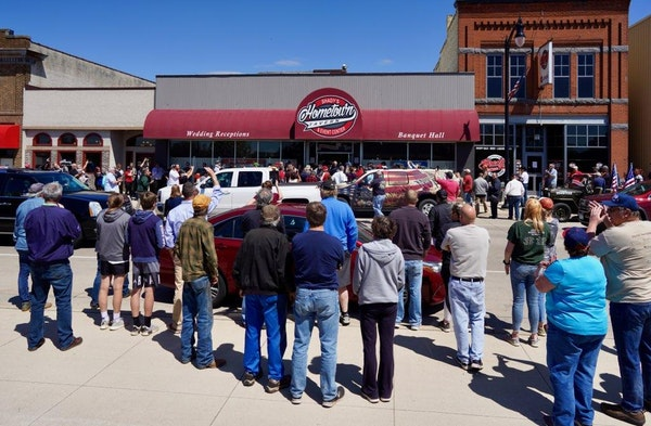 Crowds gathered outside Shady's Hometown Tavern in Albany, Minn. on Monday but the tavern decided not to reopen.