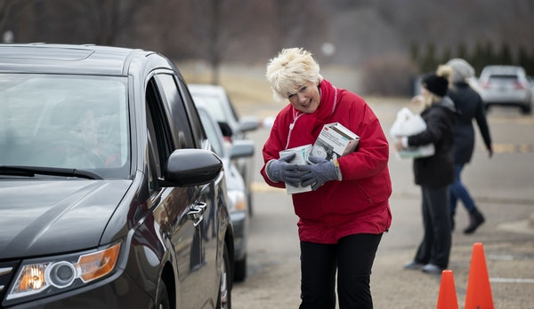 Mary Turner, president of the Minnesota Nurses Association, collected N95 masks for health care workers on March 22 at a drop of site in St. Paul.