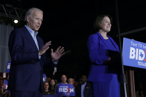 Democratic presidential candidate former Vice President Joe Biden, left, is joined by former rival Sen. Amy Klobuchar, right, during a campaign stop i