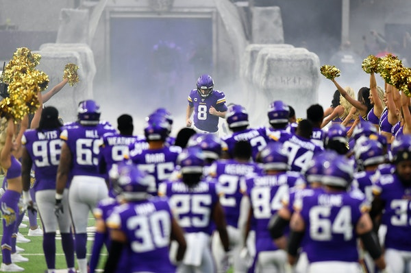 Vikings quarterback Kirk Cousins runs onto the field at the start of the game against the Lions on Dec. 8, 2019.