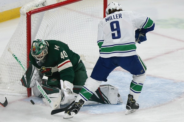 Vancouver's J.T. Miller tried to score as Wild goalie Devan Dubnyk blocked the net at Xcel Energy Center in January. The Wild would face the Canucks i