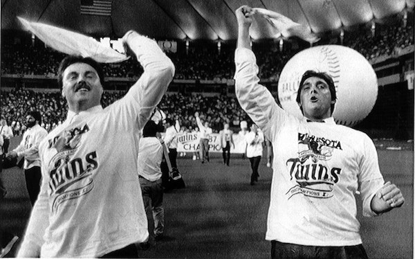 Tom Brunansky and Kent Hrbek waved to fans during the hastily planned Metrodome celebration after the Twins defeated Detroit to win the 1987 American