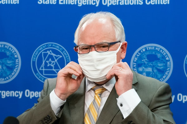 Minnesota Gov. Tim Walz put his mask back on at the conclusion of a news conference Tuesday.