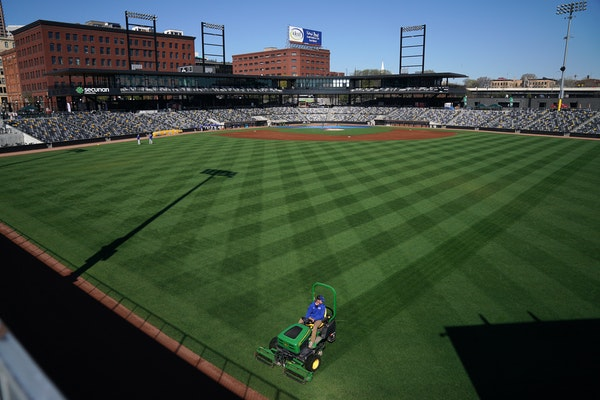 A member of the grounds crew striped the outfield ahead of a St. Paul Saints workout last May at CHS Field.