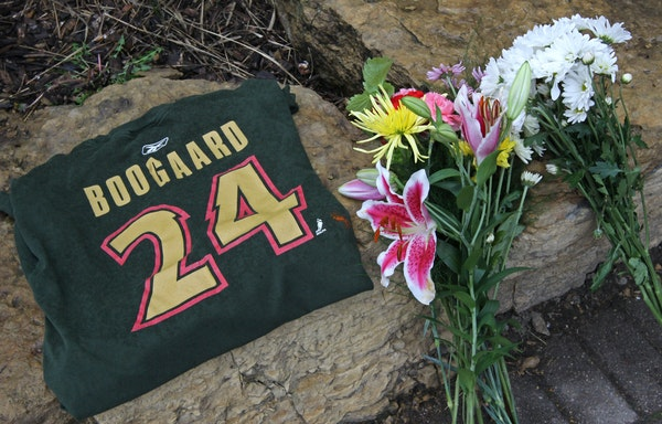 Hockey fans left a Derek Boogaard t-shirt and bundles of flowers outside of the Xcel Energy Center shortly after his death in 2011.