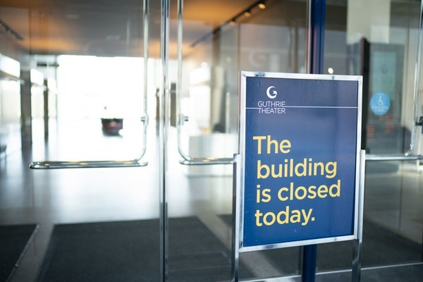 A sign at an entrance to the Guthrie Theater stated that the building was closed on Sunday.