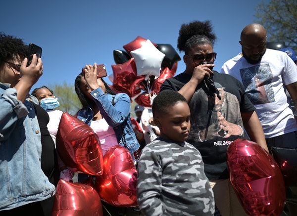 Around 50 mourners gathered on the Burns Avenue scenic overlook in St. Paul on Sunday afternoon for a memorial balloon release in honor of Douglas Lew