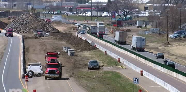 Drivers make their way through the construction zone on Hwy. 169 near Hwy. 41 south of Shakopee where MnDOT and Scott County are constructing a new in
