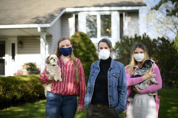 Sharon Carlson stood beside her daughters, Jaime, left, and Kristin, 26, outside their Andover home.