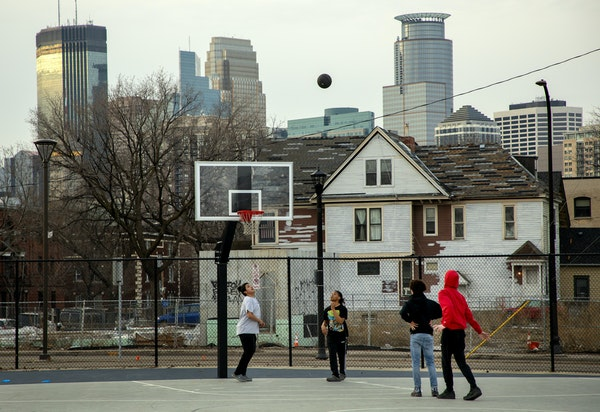 A pickup basketball game at Peavey Field Park in Minneapolis on March 26. Officials were concerned about people not practicing social distancing.