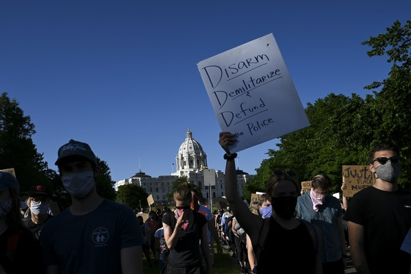 Protesters marched toward downtown St. Paul from the State Capitol on Friday night. More than 1,000 had gathered at Attorney General Keith Ellison's o