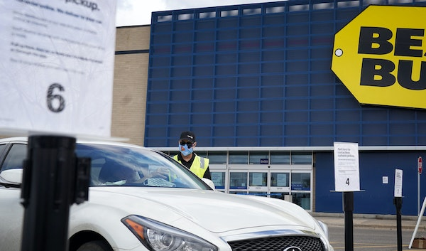 Best Buy employees brought purchases to customers' cars for curbside pickup in Apple Valley last month.