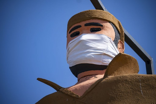 Pierre the Voyageur statue in Two Harbors, MN has been fitted with a mask amidst the COVID-19 pandemic and stood tall on April 23, 2020.