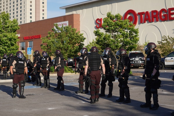 Police secured the St. Paul Midway Target after people began looting late Thursday morning.