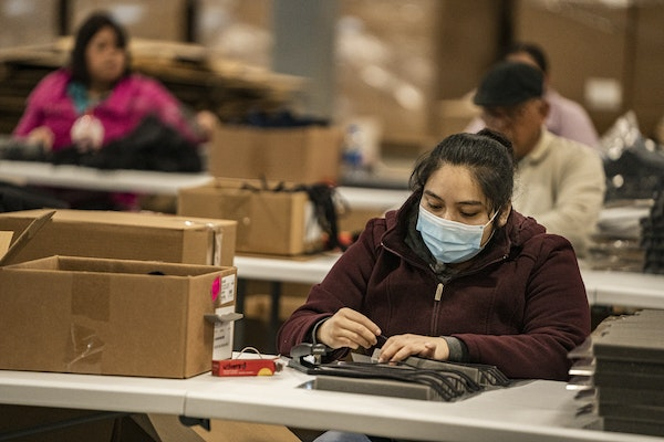 Perla Hernandez helped assemble a face shield, most likely headed to a health care worker, at Lakeview Industries in Carver.