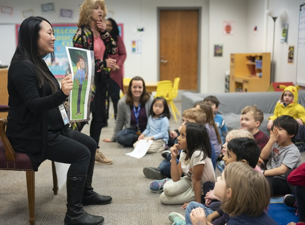 """Momo Hayakawa, a Ph.D. research associate with Ready to Learn, tests out responses to """"Hero Elementary"""" with first- and second-graders. The educat"""