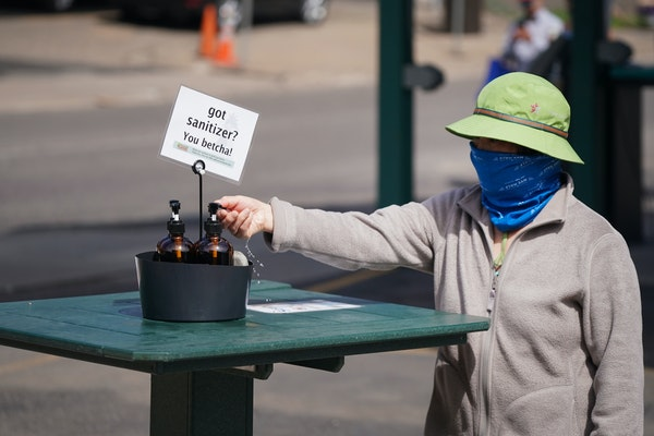 Safety precautions were in place at the Minneapolis Farmers Market on Saturday, May 2, 2020, including hand sanitizer stations, directional markers fo