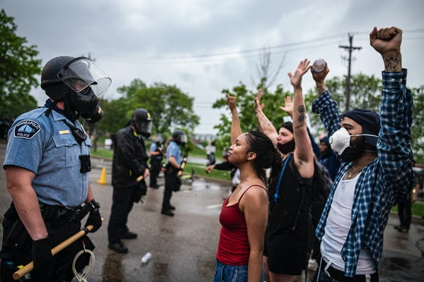 Police and protesters stood outside the 3rd Police Precinct station in 2020 after a march there over the death of George Floyd.