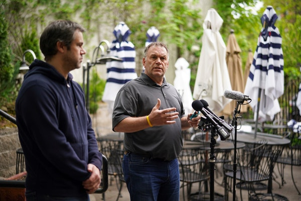 State Rep. Dave Baker, right, teamed up with Michael Asp, owner of La Grolla restaurant to talk Thursday about the hardships that eateries face by fol