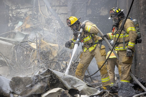 St. Paul firefighters continued to battle the fires along University Avenue, Friday, May 29, 2020 in St. Pau, MN.