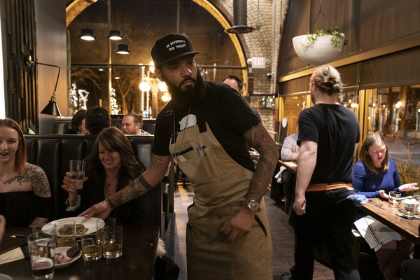 Chef and Top Chef contestant Justin Sutherland served plates of food at his restaurant the Handsome Hog in St. Paul.