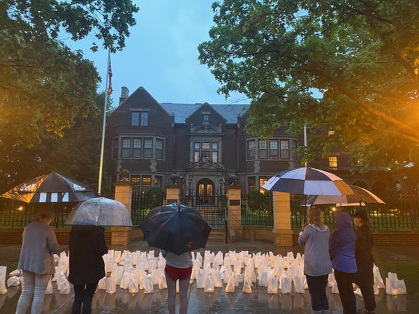 Family members of nursing home residents held a vigil last Tuesday outside the governor's residence to protest the discharges of COVID-19 patients fro