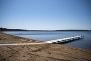 """The beach on Gull Lake at Grand View Lodge sat empty on Monday. """"It's really hard to see,"""" Resort Manager Kevin Karau said."""