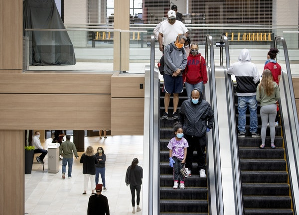 Minnesota's death toll from COVID-19 rose by 16 people on Sunday and the illness spread to 388 more people. File photo of shoppers at Rosedale Center