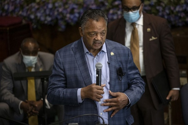 The Rev. Jesse L. Jackson, left, and his son met with faith leaders to send a message of solidarity and demand justice in the death of George Floyd at