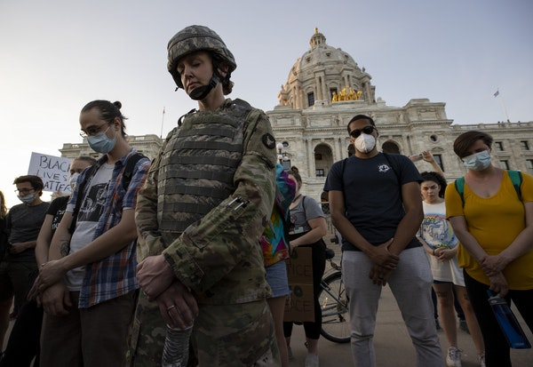 First Lt. Andrea Drost of the Minnesota Army National Guard joined protesters in a moment of prayer at the Capitol in St. Paul on Monday, June 1.