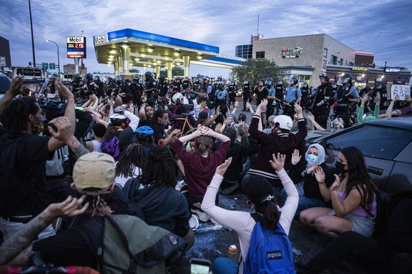 Police arrested about 150 protesters at gas station near Washington and Interstate 35W on Sunday night in Minneapolis.