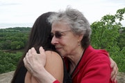 Ramona Kitto Stately embraced Rita Davern, whose Irish great-grandfather William Davern owned part of an island sacred to Stately's Dakota ancestors