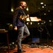 """""""Live from Here"""" frontman Chris Thile laughed with the show's house band during show at the State Theatre in Minneapolis."""