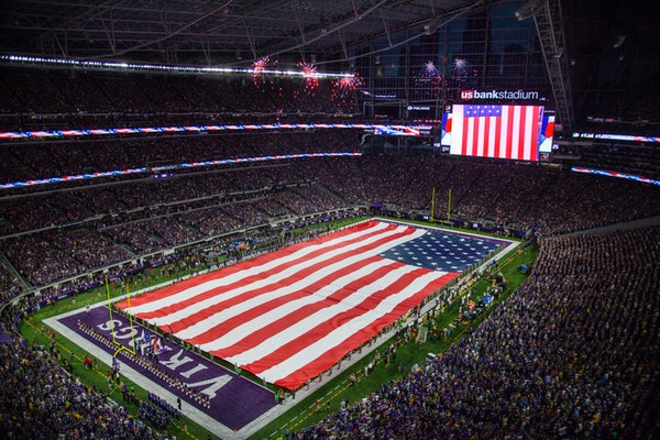 A giant American flag was unfurled before the Vikings played the Packers in 2016 at U.S. Bank Stadium.