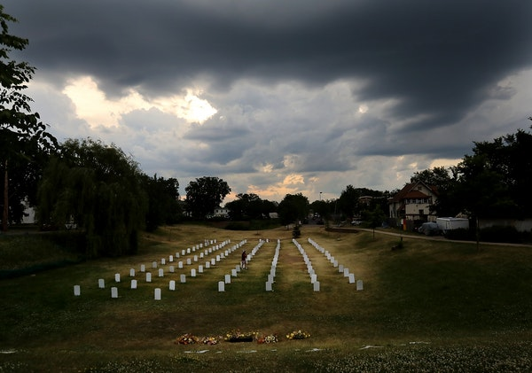 """Storm clouds were hanging Thursday over the """"Say Their Names Cemetery,"""" located in a grassy area along S. Park Avenue near where George Floyd was"""