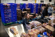 Staff and volunteers at Second Harvest Heartland, the state's largest food bank, filled emergency food kits in response to the coronavirus at its ware