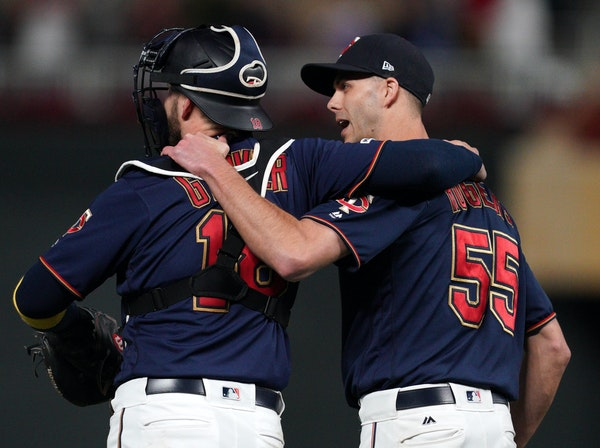 Twins catcher Mitch Garver (18) and relief pitcher Taylor Rogers won't be hugging this season.