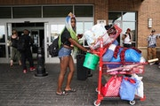 """Keke Caston used a shopping cart to evacuate from the Sheraton shelter off Lake Street Tuesday. """"We have nowhere to go,"""" she said. """"We're goin"""
