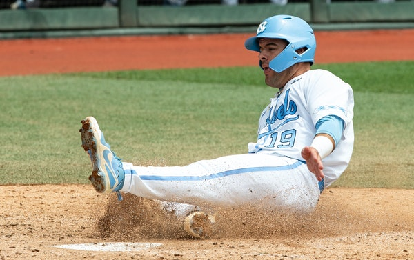 North Carolina's Aaron Sabato (19) scores a run against Auburn during Game 1 at the NCAA college baseball super regional tournament in Chapel Hill, N.