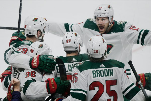 The Wild's Marcus Foligno, above right, celebrates with Greg Pateryn, left, Mats Zuccarello, second from left and Jonas Brodin after a goal on March 8