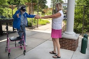 Victoria Conrad greeted her 99-year old father, Howard Seitzer, as they had their first face-to-face visit since the COVID-19 pandemic closed off Oak