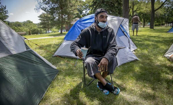After Dennis Barrow was evicted earlier in the week from a former Sheraton hotel that had been turned into a shelter, he pitched a tent at Powderhorn