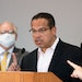 Gov. Tim Walz listened as Minnesota Attorney General Keith Ellison spoke at the press conference on Friday, May 29, about the unrest in the wake of th