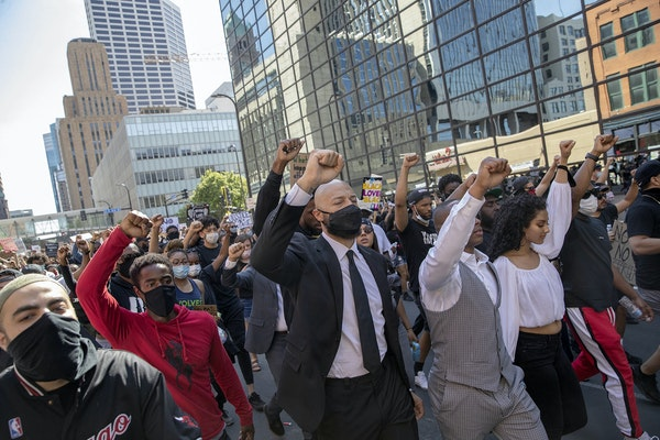 """Hundreds of people marched in the """"No Bail"""" 10K March, which started at U.S. Bank and ended up closing the 35W bridge in both directions on May 31."""