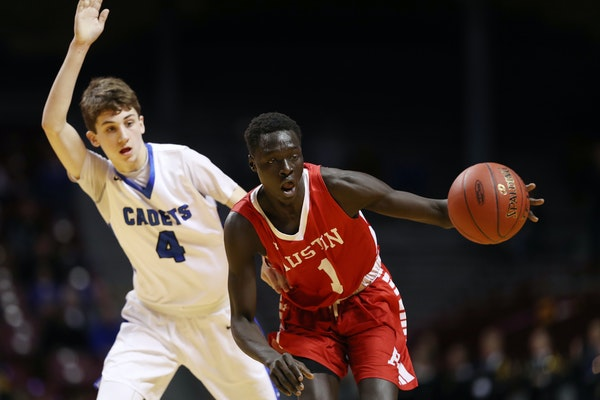 Austin's Both Gach (right, playing in the Class 3A basketball tournament in 2017) will announce his decision on where he will play his junior season o