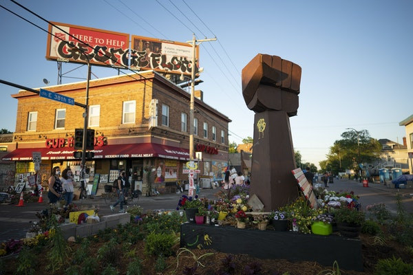 The evolving memorial to George Floyd at the intersection of 38th and Chicago Wednesday night.