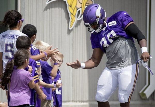 C. J. Ham with some young Vikings fans during training camp last year.